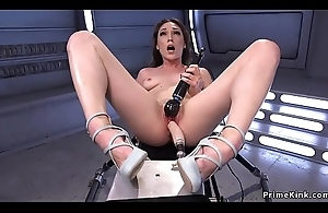 Brunette rides gadget and Sybian