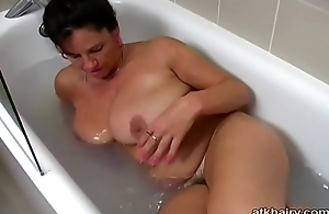 Fat tit British hairy MILF Kimberly plays with their way self in the bathtub