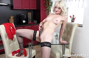 Sexy blonde in stockings pleases in the flesh with dildo