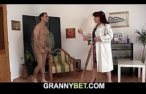 Hot redhead old woman sucks added to rides his meat