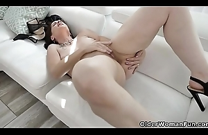 American milf Christina gives their way cookie a workout